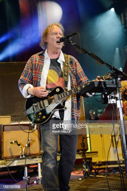 Neil Young performs onstage at the The Global Citizen Festival in Central Park to end extreme poverty Show at Central Park on September 29 2012 in...