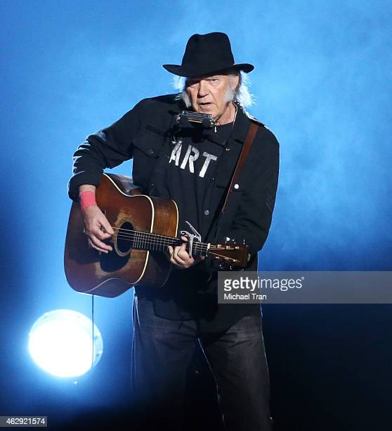 Neil Young performs onstage during the 2015 MusiCares Person of The Year honoring Bob Dylan held at Los Angeles Convention Center on February 6 2015...