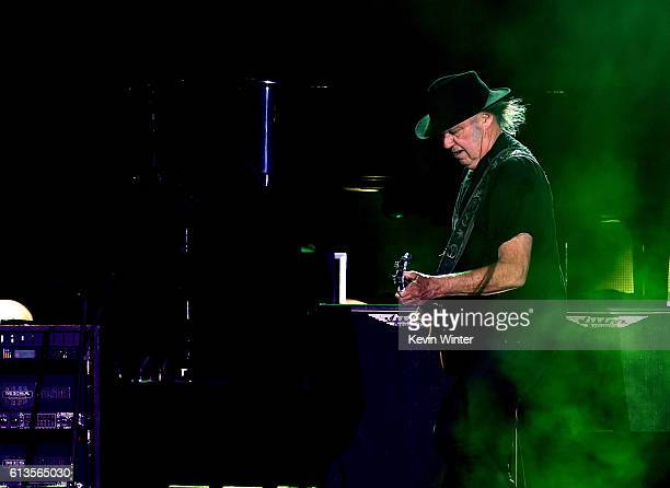 Neil Young performs with Sir Paul McCartney during Desert Trip at the Empire Polo Field on October 8, 2016 in Indio, California.