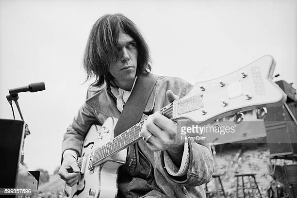 Neil Young plays his vintage Gretsch White Falcon during a sound check at Balboa Stadium just before a Crosby Stills Nash Young concert