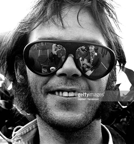 Neil Young posed backstage at Oakland Stadium California on July 14 1974 during the Crosby Stills Nash Young 1974 US Tour