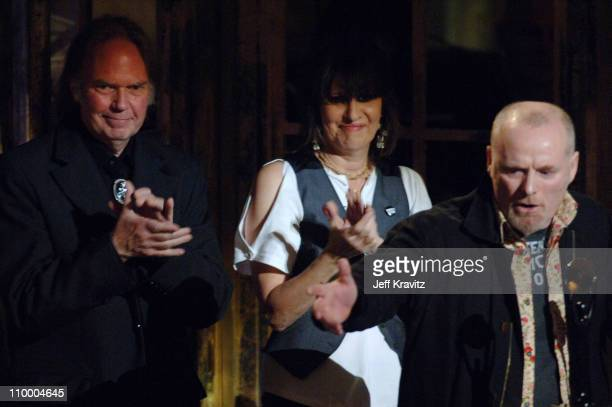 Neil Young, presenter, with Chrissie Hynde and Martin Chambers of The Pretenders, inductees