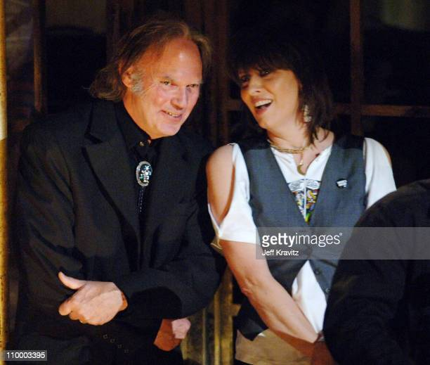 Neil Young presenter with Chrissie Hynde of The Pretenders inductee