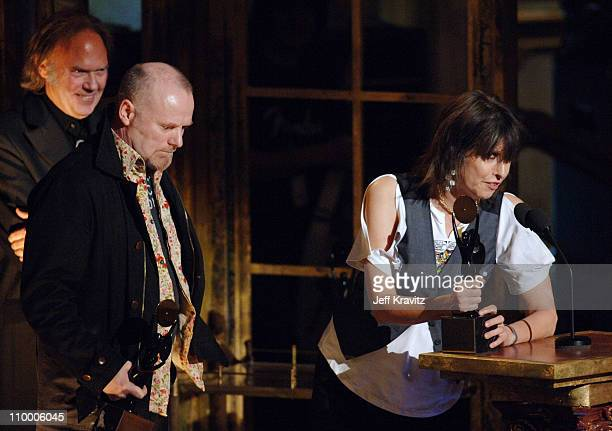 Neil Young, presenter, with Martin Chambers and Chrissie Hynde of The Pretenders, inductees