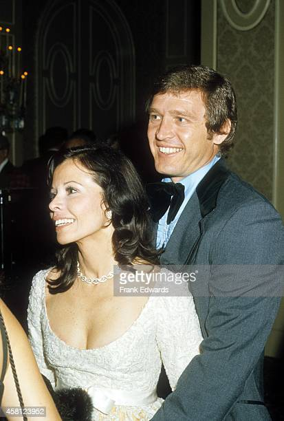 Neile Adams McQueen and boyfriend David Ross pose for a portrait at a party in 1973 in Los Angeles California
