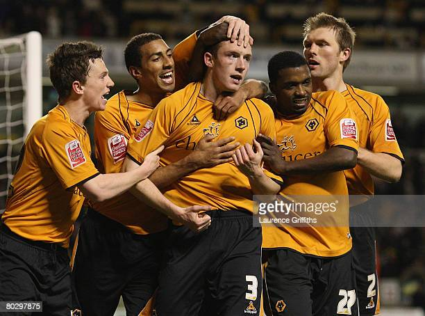 Neill Collins of Wolves is congratulated by teammates after scoring their team's second goal during the Coca-Cola Championship match between...