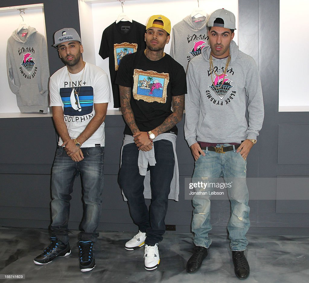 Neima Khaila, Chris Brown and Cena Barhaghi attend the Special In-Store Meet and Greet Celebration At Pink+Dolphin's Fairfax Location at Pink+Dolphin on November 7, 2012 in Los Angeles, California.