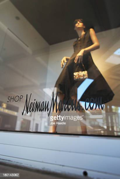 Neiman Marcus sign is seen on a store front window on September 9 2013 in Coral Gables Florida Reports indicate that Neiman Marcus is being sold for...