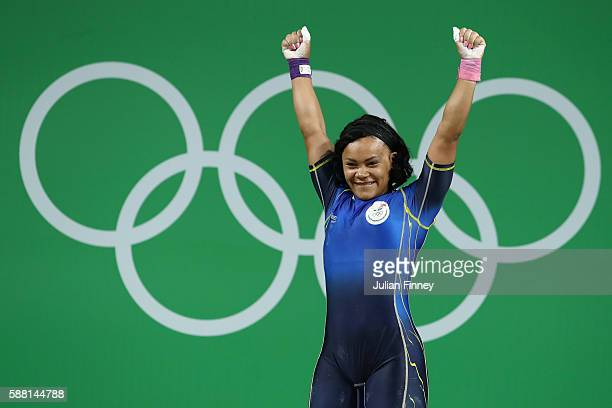 Neisi Patricia Dajomes Barrera of Ecuador celebrates after lifting during the Women's 69kg Group B weightlifting contest on Day 5 of the Rio 2016...