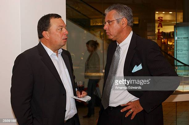 Neissing CEO Jochen Exner speaks with Managing Director Udo Pfutzenreuter at the Knockout Preview Party hosted by Jackie Kallen and Neissing Jewelry...