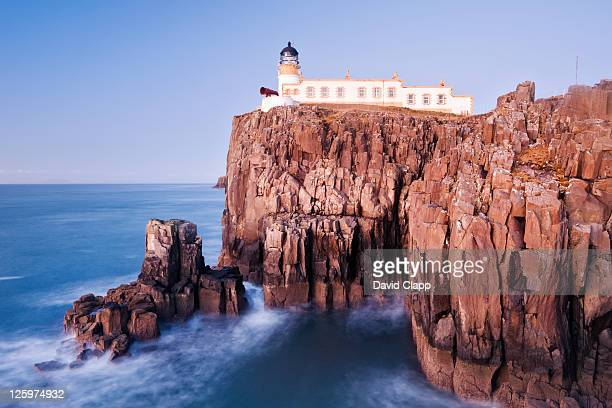 neist point lighthouse at neist point on the isle of skye, scotland, uk - david cliff stock pictures, royalty-free photos & images