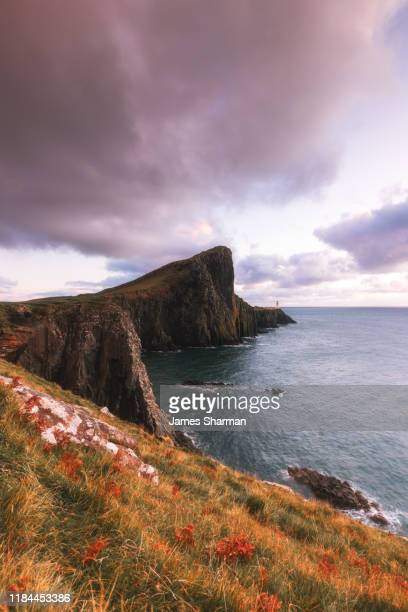 neist point lighthouse at sunset - local landmark stock pictures, royalty-free photos & images