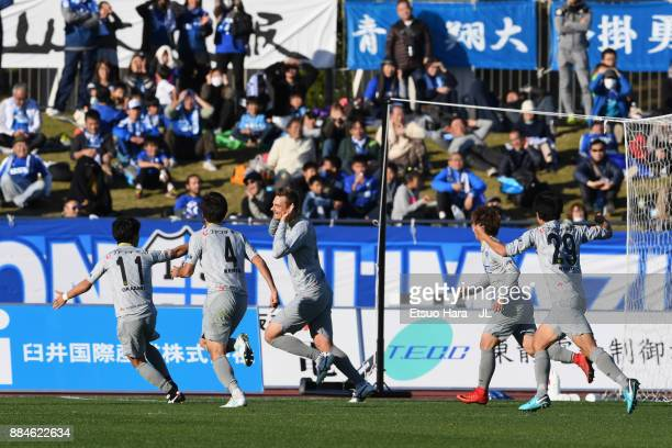 Nejc Pecnik of Tochigi SC celebrates scoring his side's first goal with his team mates during the JLeague J3 match between Azul Claro Numazu and...