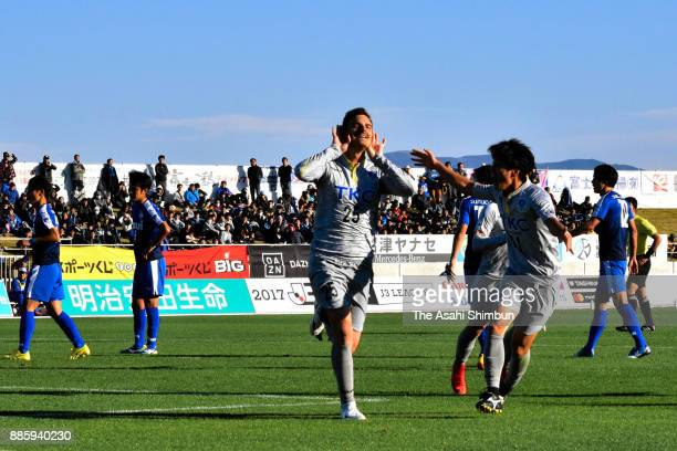 Nejc Pecnik of Tochigi SC celebrates scoring his side's first goal with his team mates during the JLeague J3 match between Azul Claro Numazu and...