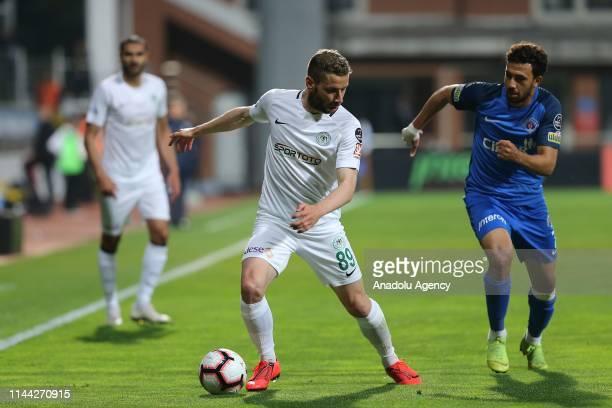 Nejc Skubic of Atiker Konyaspor in action against Trezeguet of Kasimpasa during Turkish Super Lig soccer match between Kasimpasa and Atiker Konyaspor...