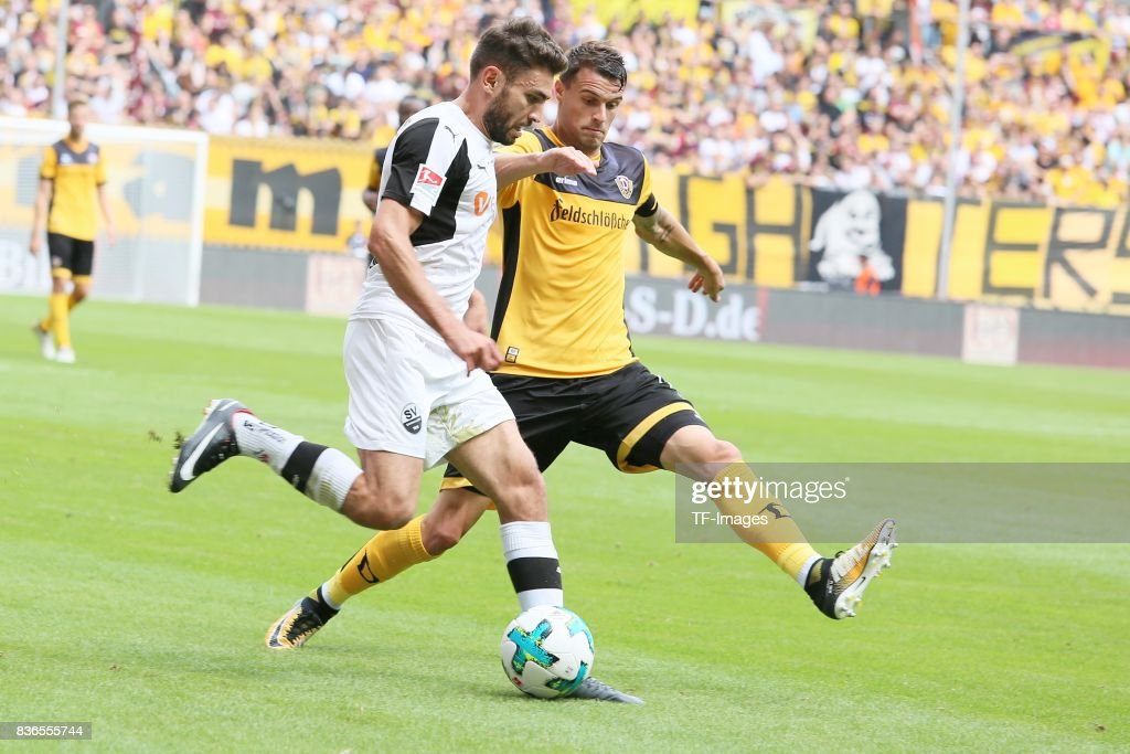Nejmeddin Daghfous of Sandhausen and Philip Heise of Dresden battle for the ball during the Second Bundesliga match between Dynamo Dresden and SV Sandhausen at DDV-Stadion on August 19, 2017 in Dresden, Germany.