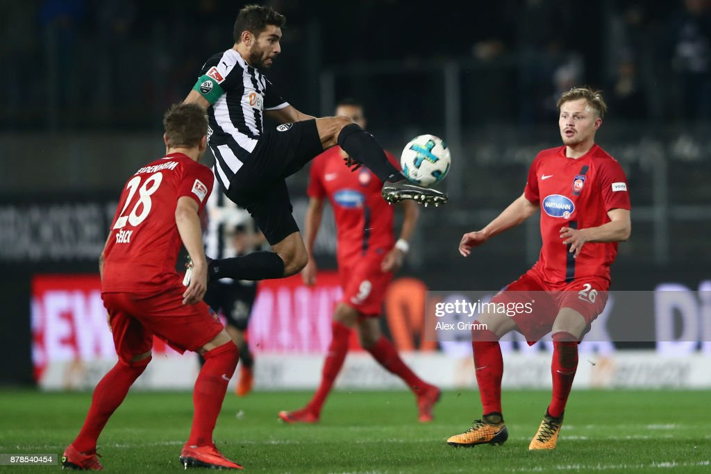 Nejmeddin Daghfous of Sandhausen controls the ball ahead of Arne Feick (L) and Marcel Titsch-Rivero of Heidenheim during the Second Bundesliga match between SV Sandhausen and 1. FC Heidenheim 1846 at BWT-Stadion am Hardtwald on November 24, 2017 in Sandhausen, Germany.