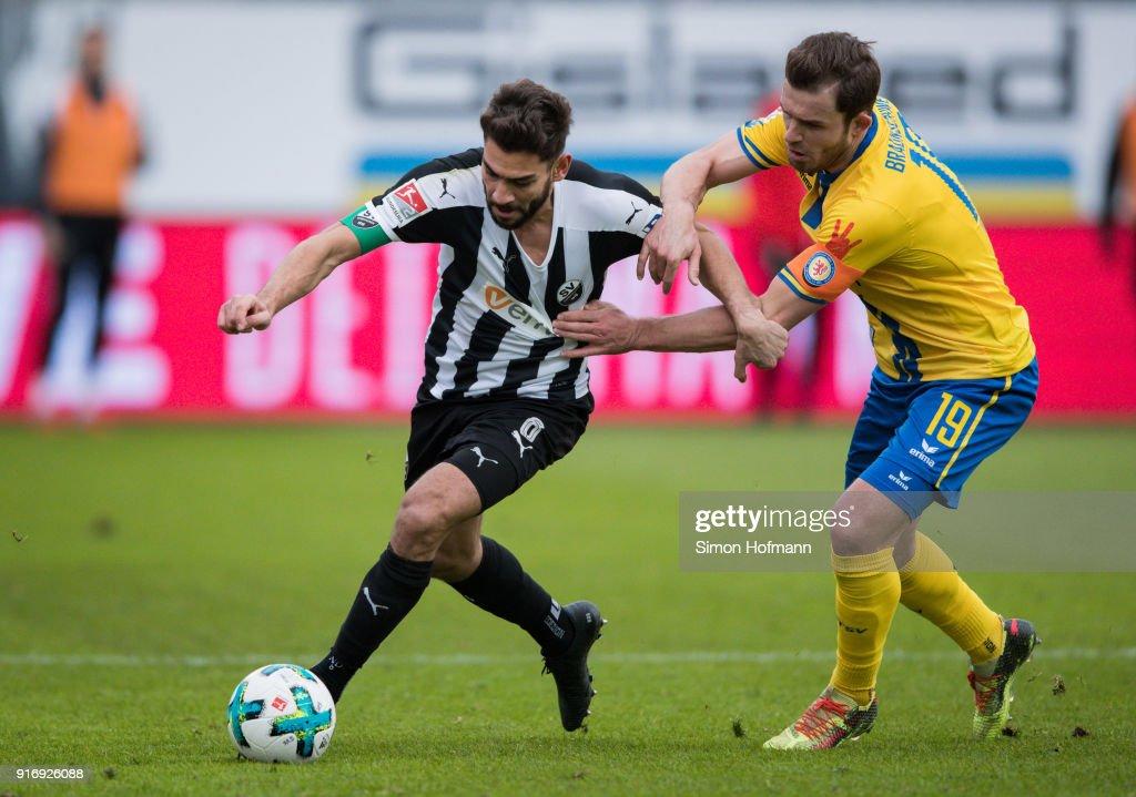 Nejmeddin Daghfous of Sandhausen is challenged by Ken Reichel of Braunschweig during the Second Bundesliga match between SV Sandhausen and Eintracht Braunschweig at BWT-Stadion am Hardtwald on February 11, 2018 in Sandhausen, Germany.