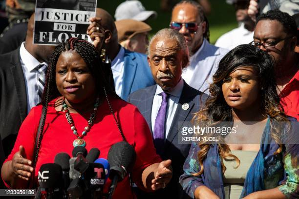 Nekima Levy Armstrong, Local Civil rights lawyer and activist flanked by Toshira Garraway , founder of Families Supporting Families Against Police...