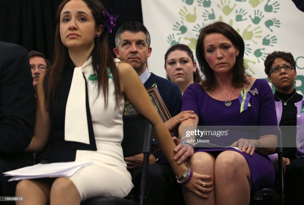 Nelba Marquez Greene (L) and Nicole Hockley (R) both mothers of Sandy Hook Elementary massacre victims, console each other during a press conference on the one month anniversary of the Newtown elementary school massacre on January 14, 2013 in Newtown, Connecticut. Eleven families of Sandy Hook massacre victims came to the event one month after the shooting to give their support to Sandy Hook Promise, a new non-profit with the goal of preventing such tragedies in the future.
