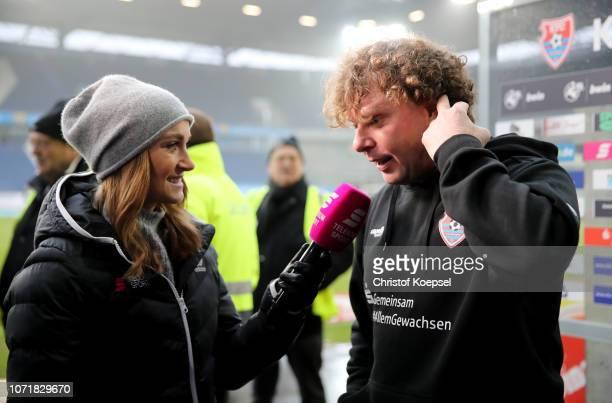 Nele Schenker field reporter of Telekom Sport interviews head coach Stefan Kraemer of Uerdingen prior to the 3 Liga match between KFC Uerdingen 05...