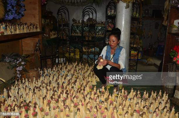 Neli Chachea Mao gives a finishing touch to her product of homemade Barbie Doll at her workshop at Mao Gate under Senapati District of the India...
