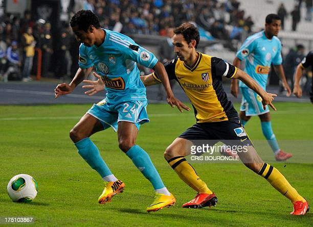 Nelinho Quina from Peruvian Sporting Cristal and Juan Fran of Atletico Madrid vie for the ball during their Euroamerican Cup football match at the...