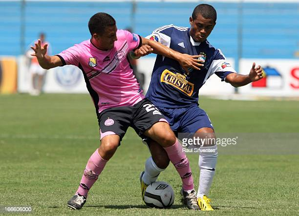 Nelinho Quina of Sporting Cristal fights for the ball with Angel Perez of Pacifico FC during a match between Sporting Cristal and Pacifico FC as part...