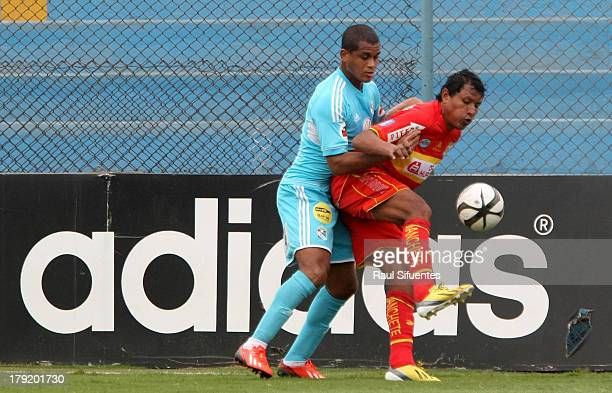 Nelinho Quina of Sporting Cristal fights for the ball with Angelo Cruzado of Sport Huancayo during a match between Sporting Cristal and Sport...