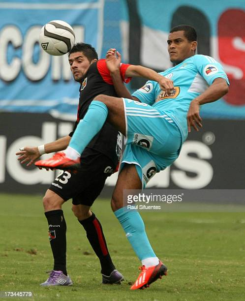 Nelinho Quina of Sporting Cristal fights for the ball with Bosco Frontan of Melgar FC during a match between Sporting Cristal and Melgar FC as part...