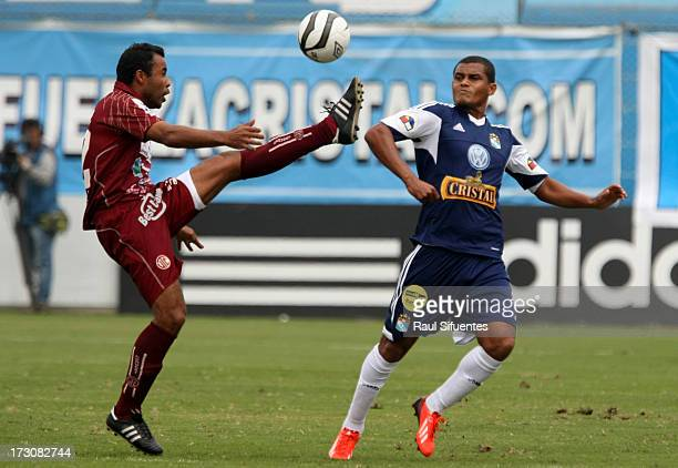 Nelinho Quina of Sporting Cristal fights for the ball with Donny Neyra of UTC during a match between Sporting Cristal and UTC as part of the Torneo...