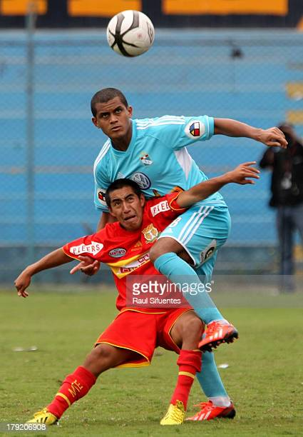 Nelinho Quina of Sporting Cristal fights for the ball with Edson Avila of Sport Huancayo during a match between Sporting Cristal and Sport Huancayo...