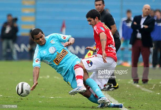 Nelinho Quina of Sporting Cristal fights for the ball with German Pacheco of Juan Aurich during a match between Sporting Cristal and Juan Aurich as...
