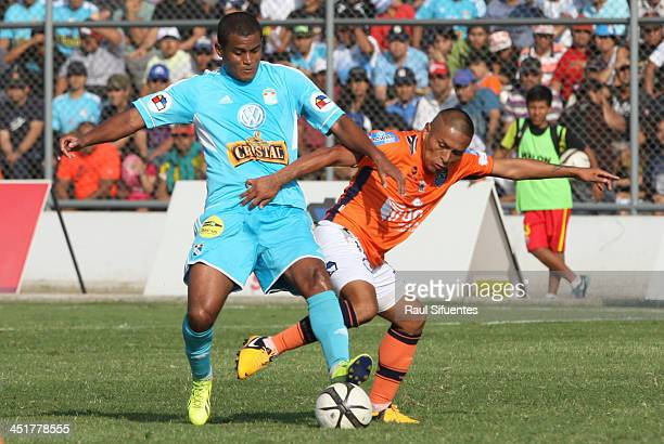 Nelinho Quina of Sporting Cristal fights for the ball with Johan Sotil of Cesar Vallejo during a match between Cesar Vallejo and Sporting Cristal as...