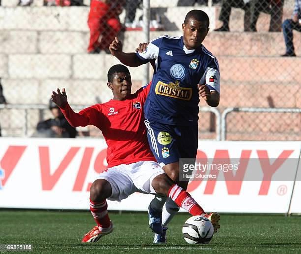 Nelinho Quina of Sporting Cristal fights for the ball with Junior Castrillon of Cienciano during a match between Sporting Cristal and Cienciano as...