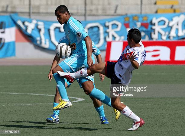 Nelinho Quina of Sporting Cristal fights for the ball with Manuel Tejada of Jose Galvez during a match between Jose Galvez and Sporting Cristal as...