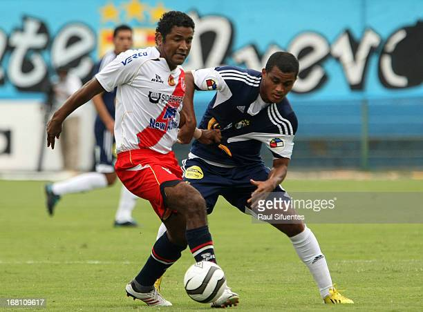 Nelinho Quina of Sporting Cristal fights for the ball with Marco Ruiz of Jose Galvez during a match between Sporting Cristal and Jose Galvez as part...