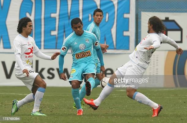 Nelinho Quina of Sporting Cristal fights for the ball with Mauricio Montes of Real Garcilaso during a match between Sporting Cristal and Real...