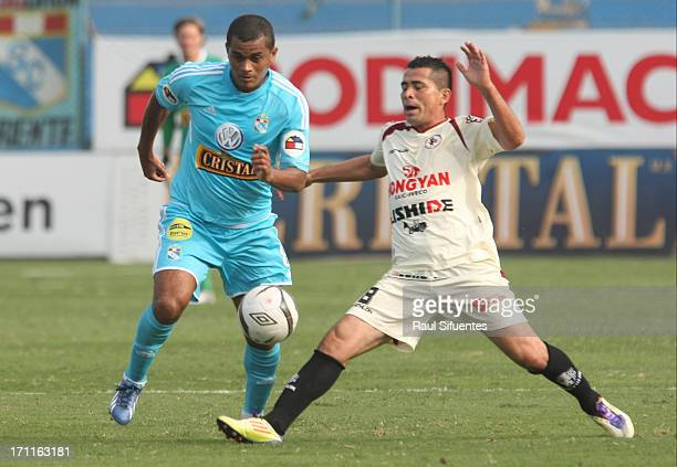 Nelinho Quina of Sporting Cristal fights for the ball with Pedro Ascoy of Leon de Huanuco during a match between Sporting Cristal and Leon de Huanuco...