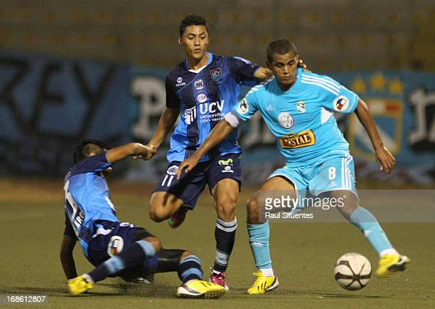 Nelinho Quina of Sporting Cristal fights for the ball with Ronald Quinteros of Cesar Vallejo during a match between Cesar Vallejo and Sporting...
