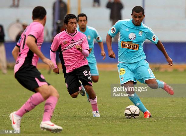 Nelinho Quina of Sporting Cristal fights for the ball with Sheu Obregon of Pacifico FC during a match between Pacifico FC and Sporting Cristal as...