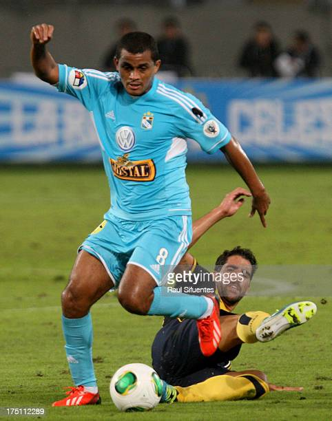Nelinho Quina of Sporting Cristal fights for the ball with Tiago of Atletico de Madrid during a match between Sporting Cristal and Atletico de Madrid...
