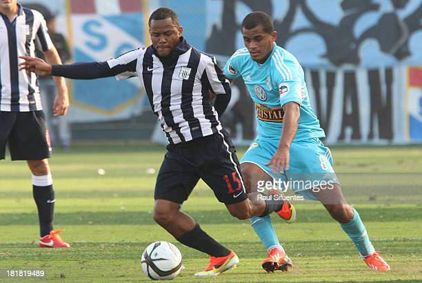 Nelinho Quina of Sporting Cristal fights for the ball with Wilmer Aguirre of Alianza Lima during a match between Sporting Cristal and Alianza Lima as...