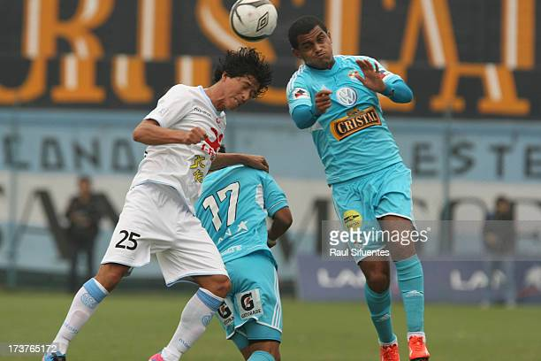 Nelinho Quina of Sporting Cristal fights for the ball with Yosiro Salazar of Real Garcilaso during a match between Sporting Cristal and Real...