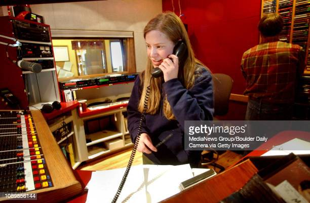 Nell Geiser speaks to a caller that will be part of an interview panel during the morning show at KGNU community radio. Geiser is the co-news...