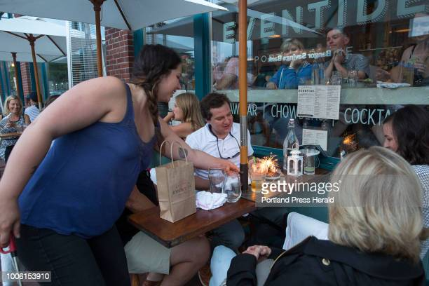 Nell HendersonBrown an assistant manager at Eventide serves a dessert topped with provided sparkler candles to John Winters III Cape Elizabeth on his...