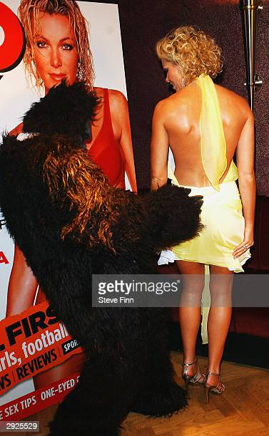 Nell McAndrew poses with a gorilla at the launch of new magazine Zoo Weekly at No 5 Cavendish Square on February 3 2004 in London