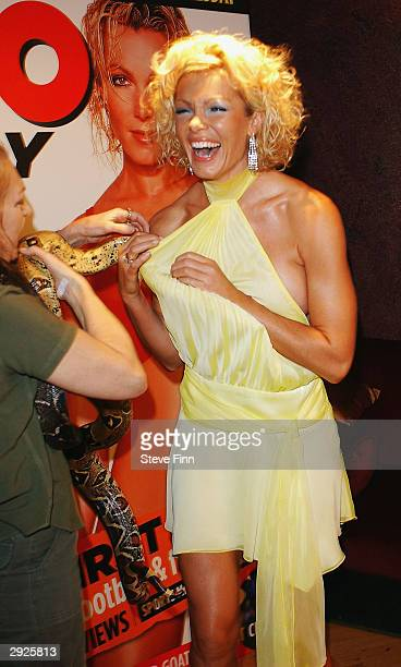 Nell McAndrew poses with snakes at the launch of new magazine Zoo Weekly at No 5 Cavendish Square on February 3 2004 in London