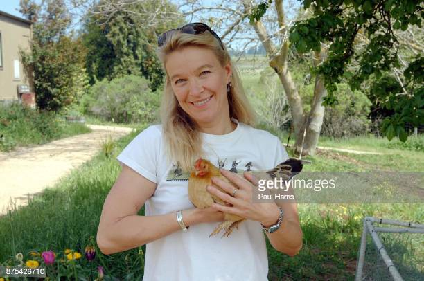 Nell Newman is the daughter of American actor Paul Newman and actress Joanne Woodward she stands in the garden of her home with a chicken , a project...