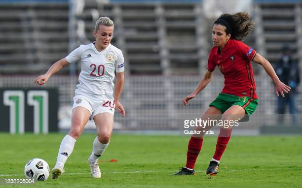 Nelli Korovkina of Russia with Dolores Silva of Portugal in action during the UEFA Women's EURO 2022 play-offs match between Portugal and Russia at...